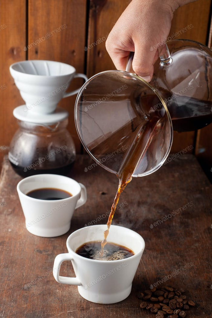 barista pouring third wave coffee Chemex