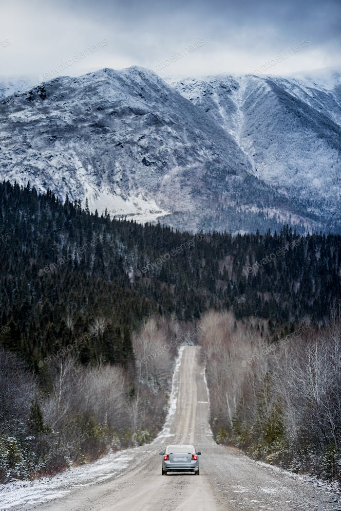 Winter Straight Road with Beautiful Snowy Mountains in Backgroun