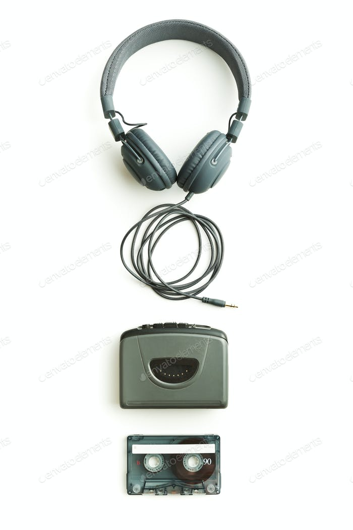 Vintage walkman, audio tape and headphones.