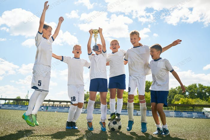 Junior Football Team Celebrating Victory