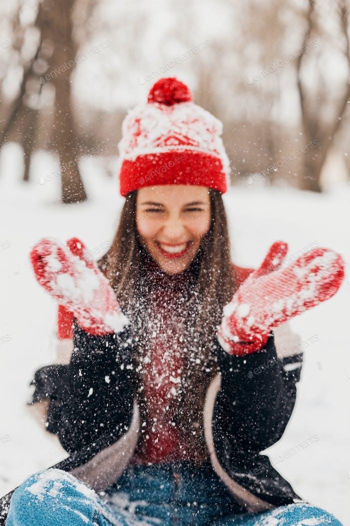smiling woman having fun in winter park