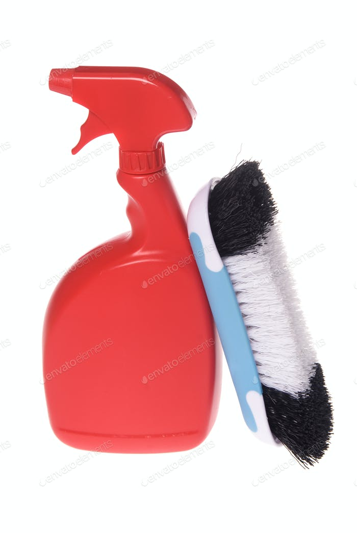 Spray bottle of cleaner with brush