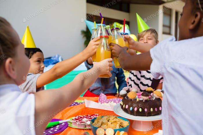 Children toasting juice