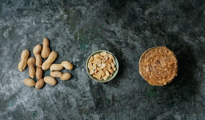 Heap of peanuts in a shell, bowl of roasted salted peanuts and bowl of peanut butter