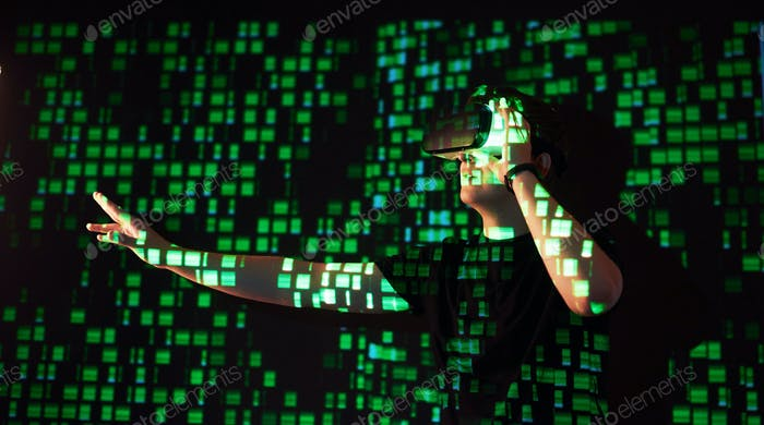Double exposure of a caucasian man and Virtual reality headset is presumably a gamer or a hacker