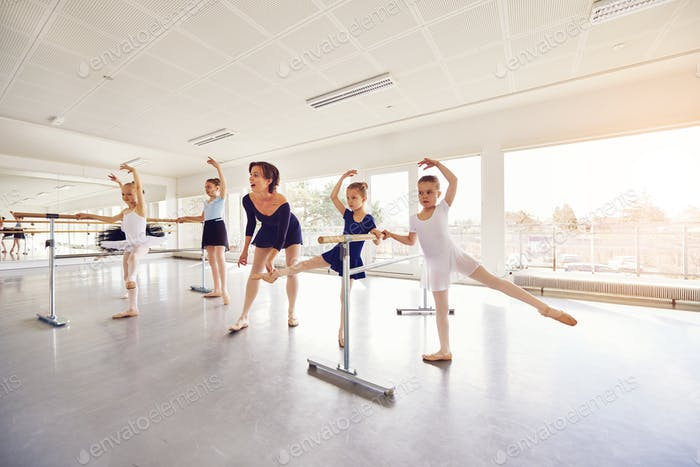 Woman exercising with group of small ballerinas