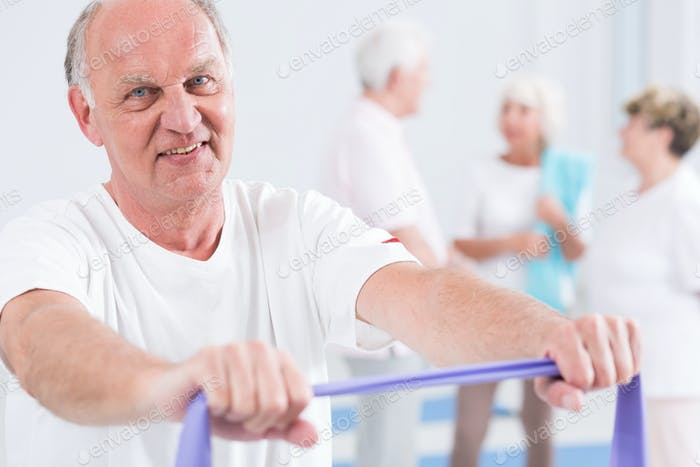 Man exercising with exercise band