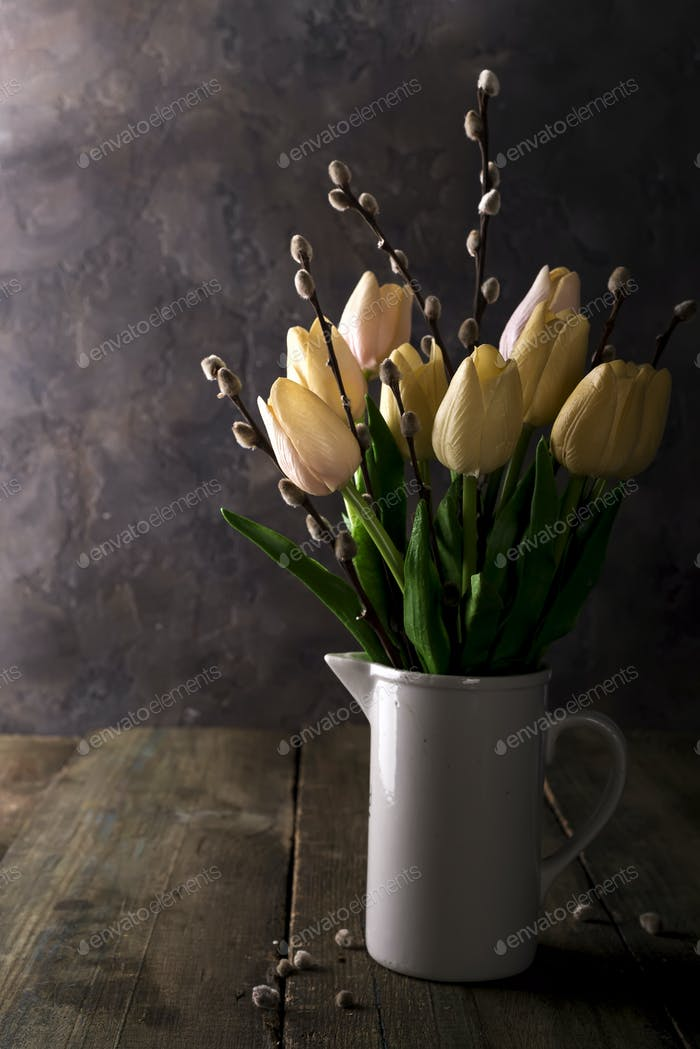 spring tulips with branches of the seal on rustic background
