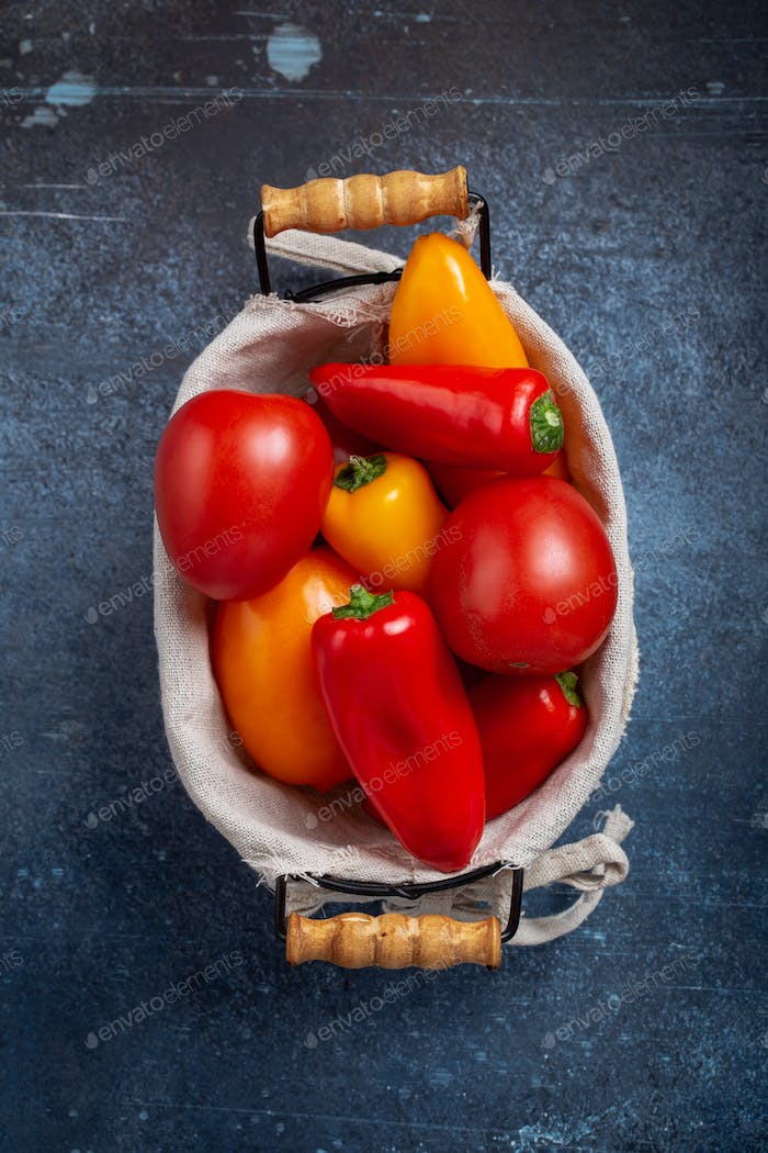 Tomato and peppers in basket