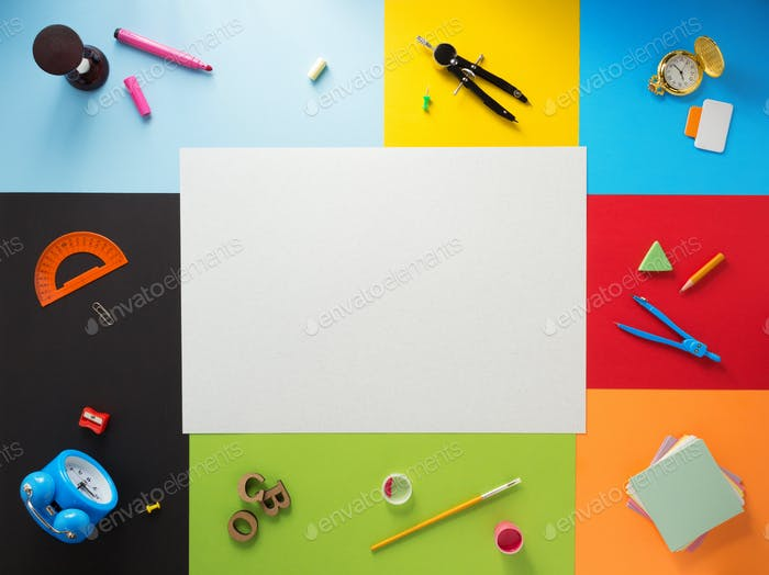 school supplies at abstract colorful background
