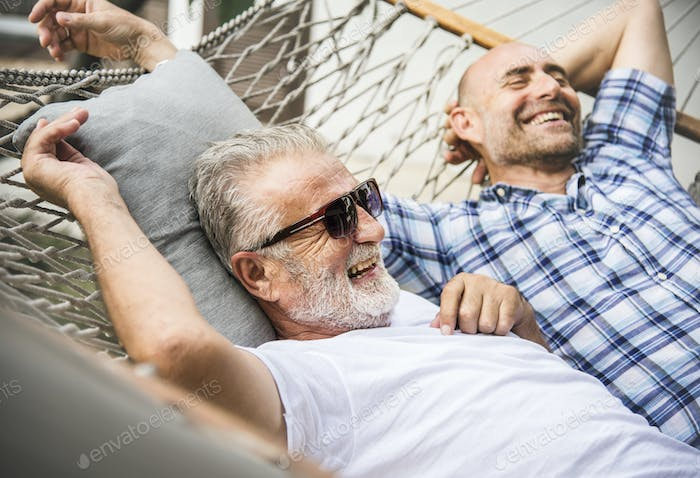 Senior men chilling on a hammock
