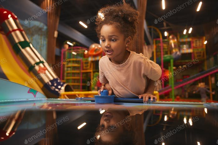 Girl playing in table hockey