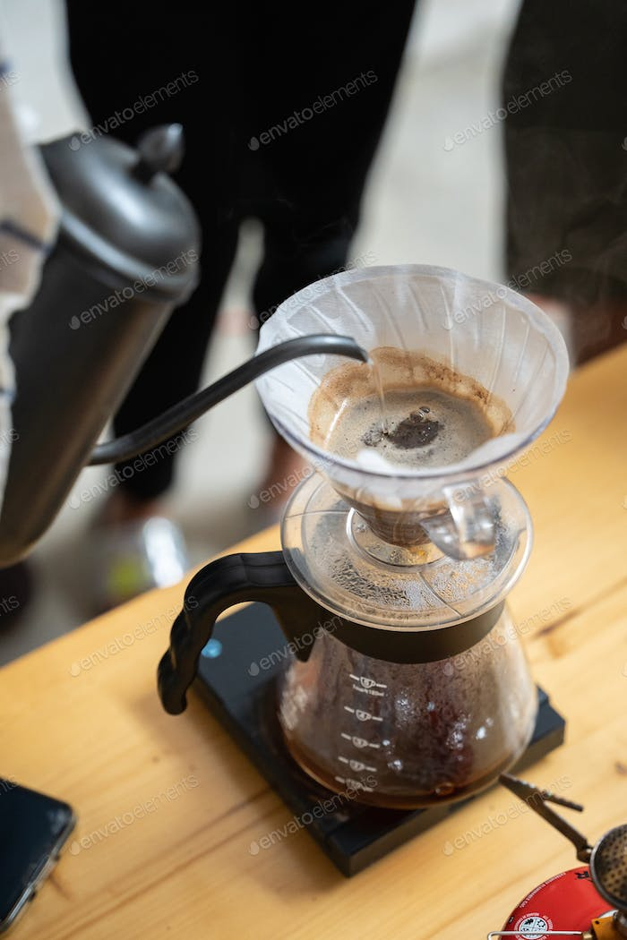 Making process of V60 coffee, filter coffee, pouring hot water on the coffee