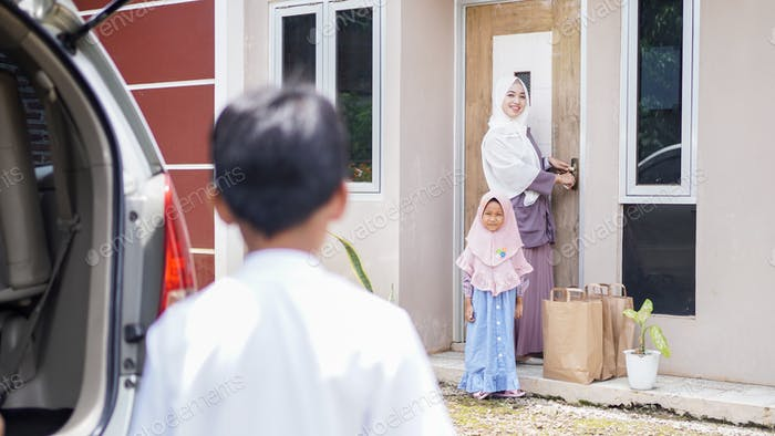 Muslim families travel back to their hometowns by car to celebrate Eid