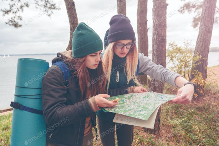 Women travelers with the map