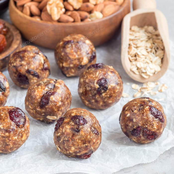 Energy balls with cranberries, nuts, dates and rolled oats, square format
