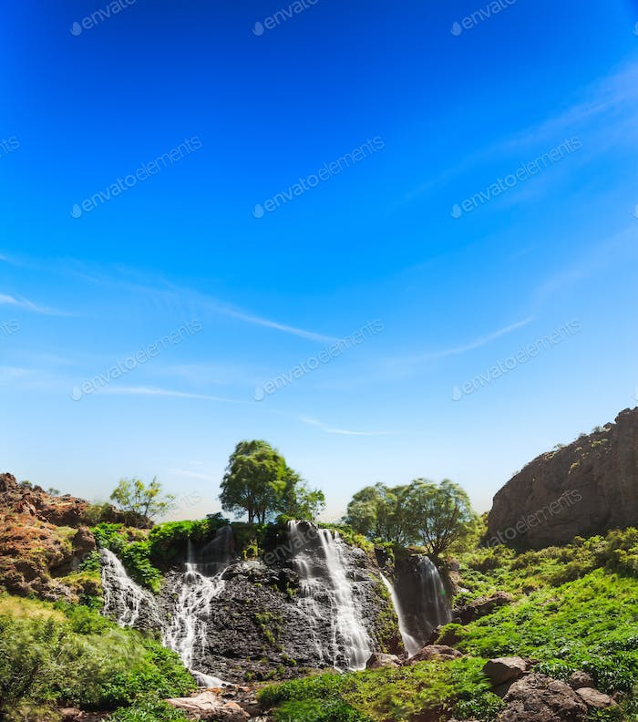waterfall with blue sky