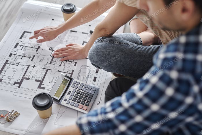 Close up of couple calculating costs of new house