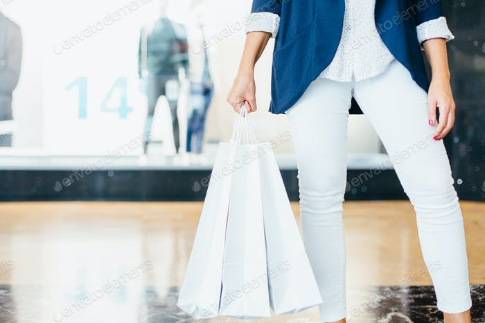 Shopper holding buyings
