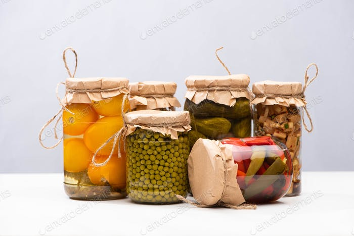 Homemade Delicious Pickles in Jars Isolated on Grey