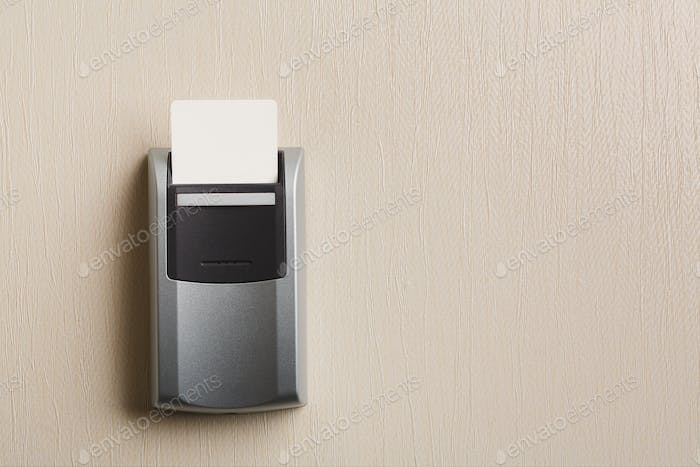 Insert key card in electronic lock in hotel