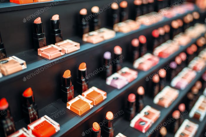 Lipstick collection in beauty shop closeup, nobody