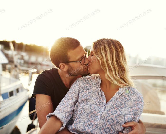Man And Woman Kissing on a Boat