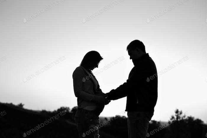 Pregnant couple silhouettes