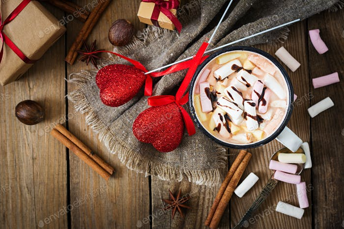 Cup of hot cocoa or chocolate with marshmallow on  wooden background. Flat lay. Top view
