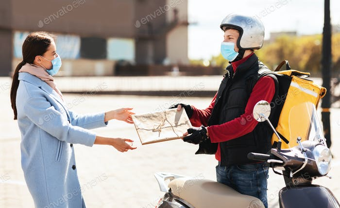 Courier In Mask Delivering Package To Customer In Urban Area