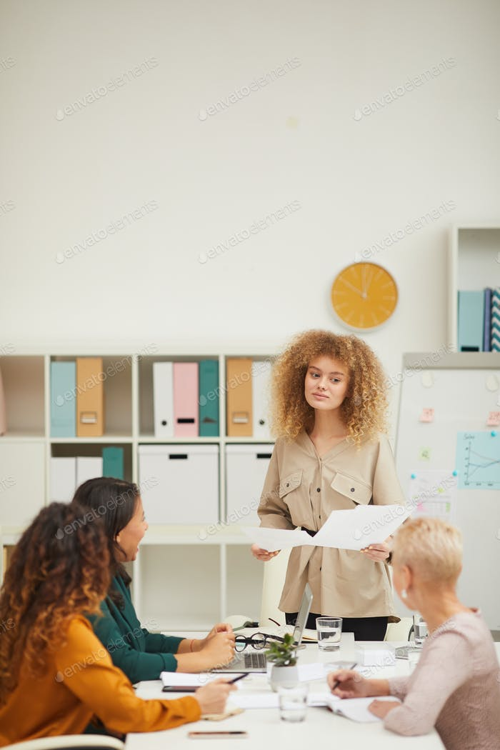 Businesswoman Demonstrating Revenue Statistics