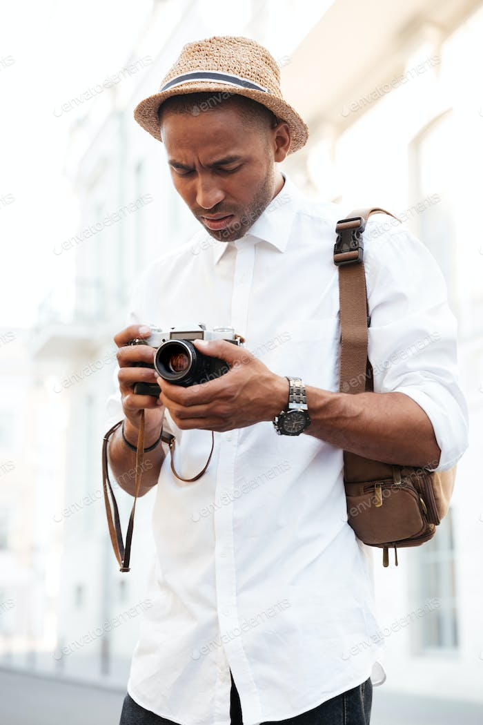 Afro american with camera