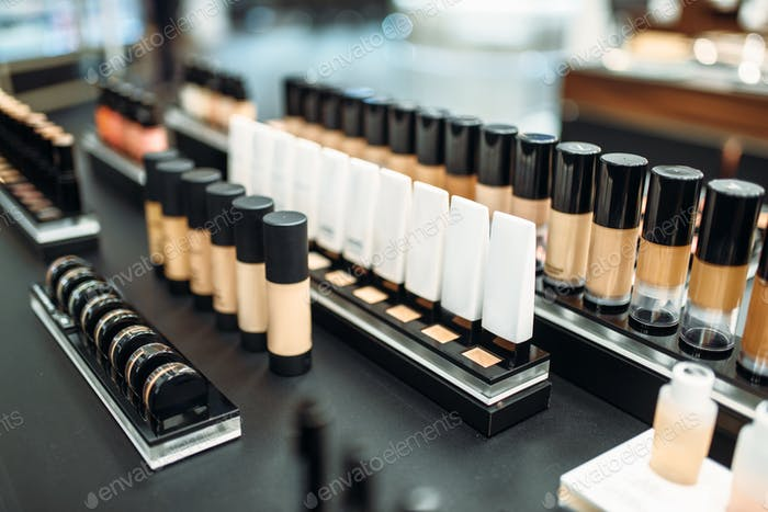 Face cosmetic collection in make-up shop closeup