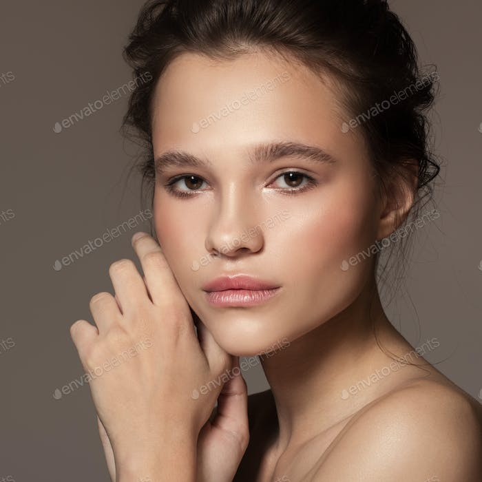 Fashion Portrait Of Young Beautiful Woman. Perfect Skin.