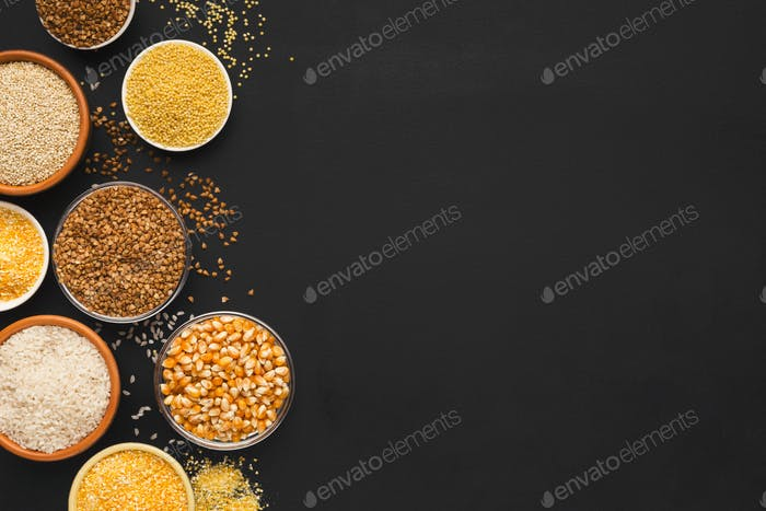 Various gluten free groats on black background with copy space