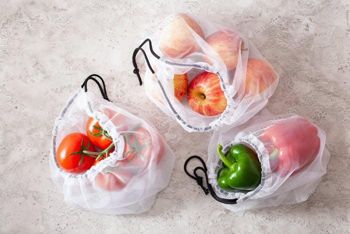 apples tomatoes bell peppers vegetables in reusable mesh nylon b