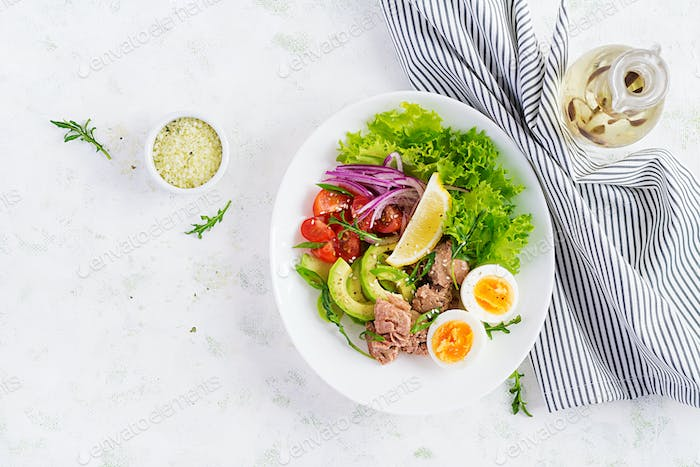 Tuna fish salad with eggs, lettuce, cherry tomatoes, avocado and red onions.