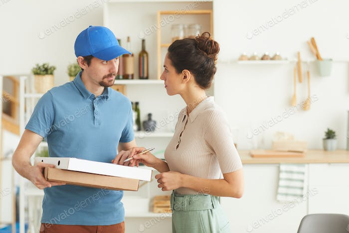 Young woman getting the pizza