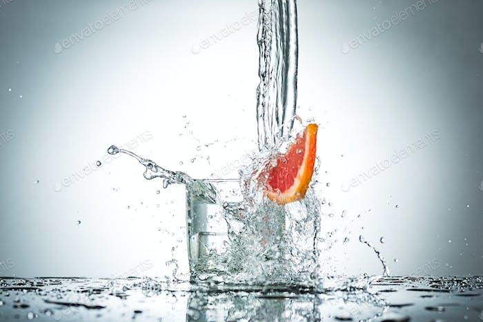 water splash in glass of gray color