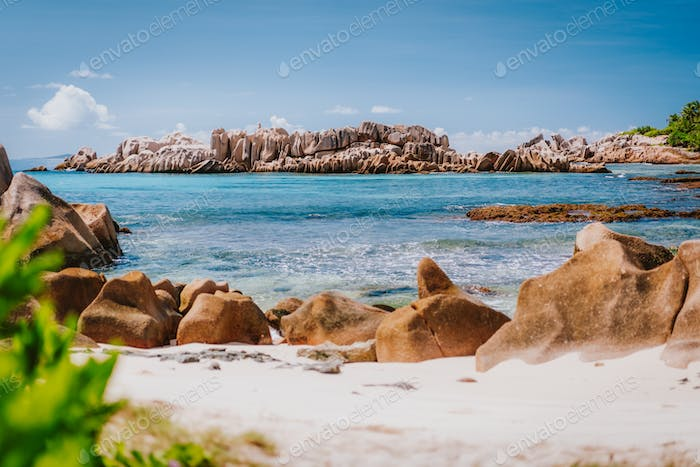 Granite rocks in tropical ocean bay on La Digue island, Seychelles. Beautiful exotic landscape on