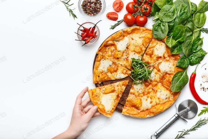 Hand picking slice of cheesy pizza, top view