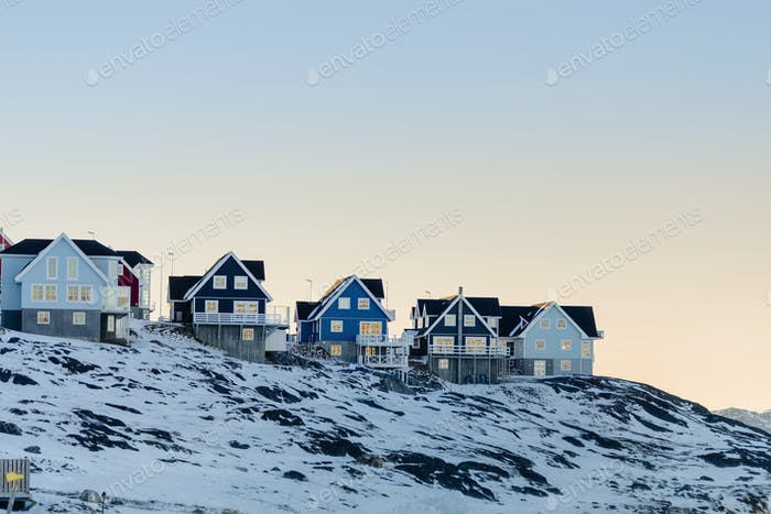 Snowy landscape with residential buildings