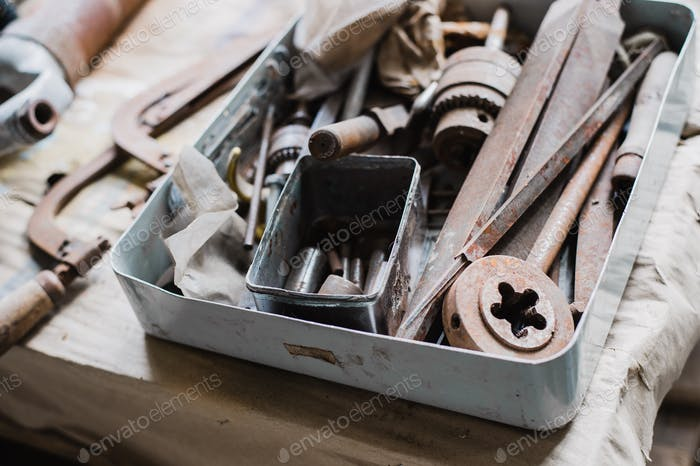 still life tool box with nails rasp and old tools