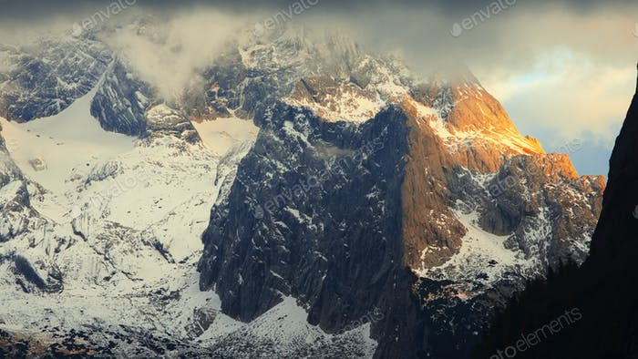 Panorama of Dachstein mountains peaks with sunset light Austria.
