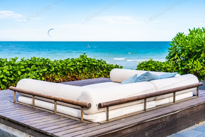 Beautiful outdoor nature landscape with pillow on sofa and loung