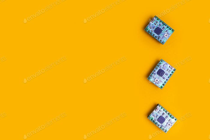 three microcircuit over orange background minimal engineering concept