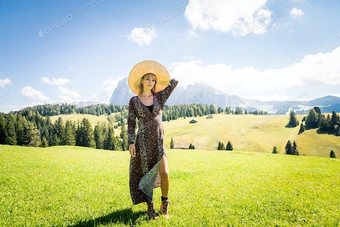 Beautiful woman enjoying a trip in the nature