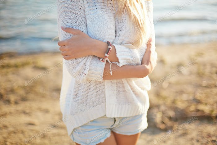 Girl in white pullover