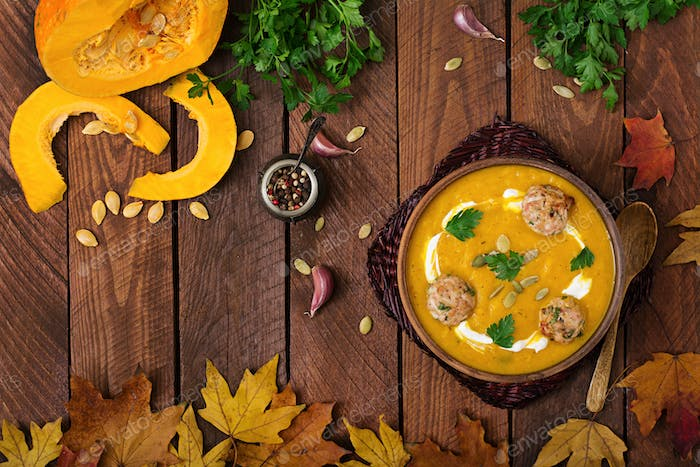 Delicious cream of pumpkin soup with meatballs