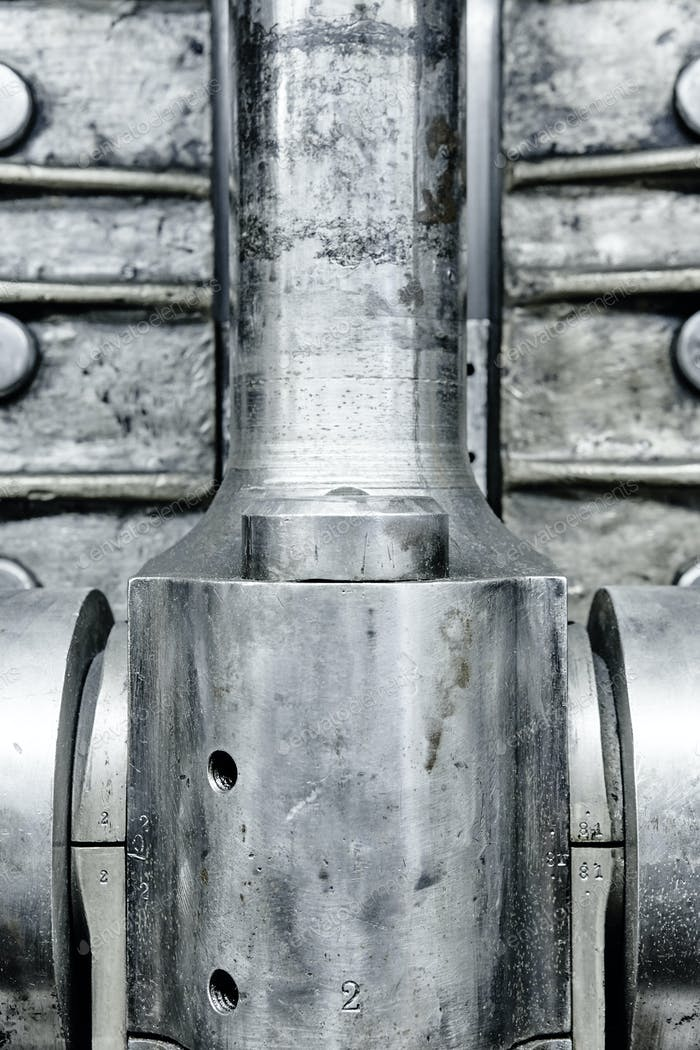 Engine valve detail. Industrial steel equipment. Powerful background. Vertical